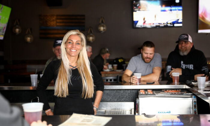Lisa Monet Zarza, owner of Alibi Drinkery in her bar in the Minneapolis metropolitan area, Minn., on Dec. 31, 2020. (Charlotte Cuthbertson/The Epoch Times)