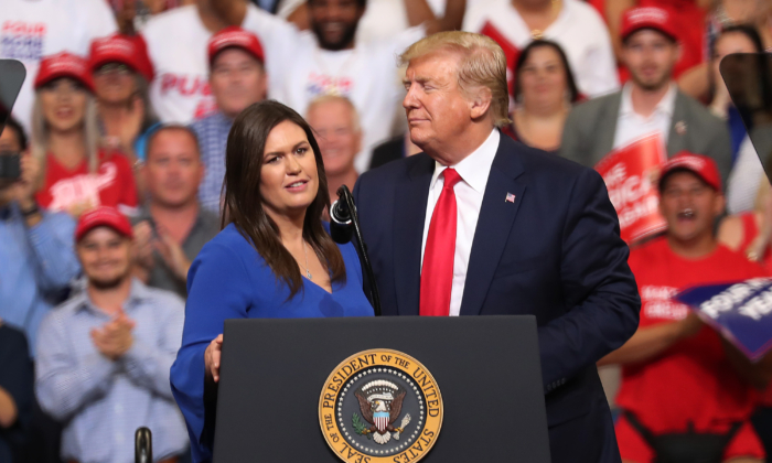 President Donald Trump stands with Sarah Huckabee Sanders, who announced that she is stepping down as the White House press secretary, during his rally where he announced his candidacy for a second presidential term at the Amway Center on June 18, 2019 in Orlando, Florida.  President Trump is set to run against a wide open Democratic field of candidates. (Photo by Joe Raedle/Getty Images)