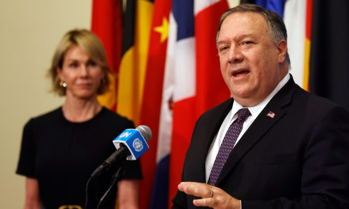 U.S. Secretary of State Mike Pompeo is flanked by U.S. Ambassador to the United Nations Kelly Craft as he speaks to reporters at the United Nations headquarters in New York, on Aug. 20, 2020. (Mike Segar/POOL/AFP via Getty Images)