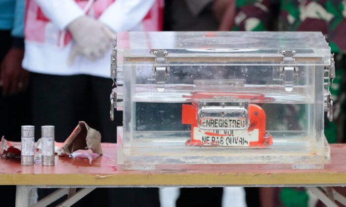 A box containing the flight data recorder recovered from the crash site of the Sriwijaya Air flight SJ-182 in the Java Sea sits on display at Tanjung Priok Port, on Jan. 12, 2021. (Dita Alangkara/AP Photo)