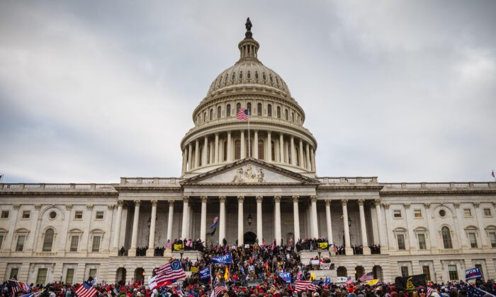 A large group of protesters stand on the East steps of the Capitol Building in Washington, on Jan. 6, 2021. (Jon Cherry/Getty Images)