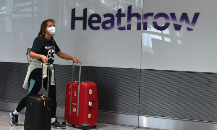 Passengers arrive at Heathrow Airport, west London, on July 10, 2020. (Daniel Leal-Olivas/AFP via Getty Images)