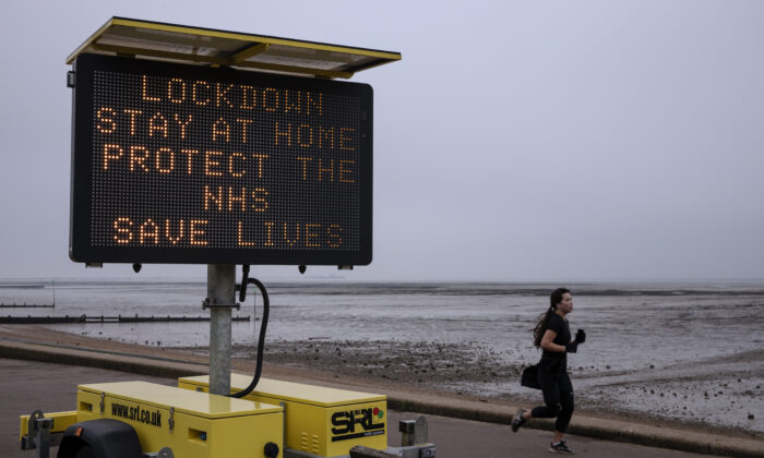A sign asking people to stay at home stands on the sea front in Southend, England on Jan. 08, 2021.  (Dan Kitwood/Getty Images)