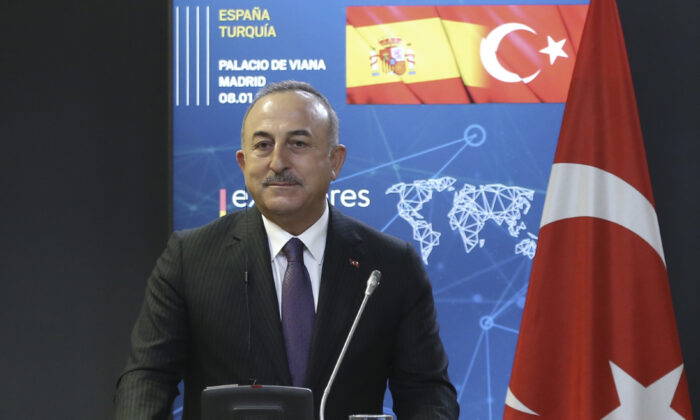 Turkish Foreign Minister Mevlut Cavusoglu speaks at a news conference in Madrid, Spain on Jan. 8, 2021. (Turkish Foreign Ministry via AP, Pool)
