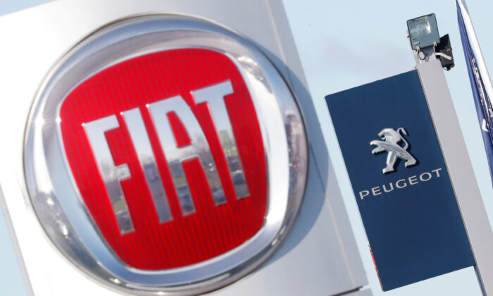 The logos of Fiat and Peugeot are seen in Saint-Nazaire, France, on Nov. 8, 2019. (Stephane Mahe/Reuters)