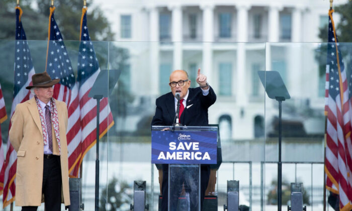 Chapman University law professor John Eastman (L) watches as Rudy Giuliani speaks to supporters from the Ellipse, near the White House on Jan. 6, 2021. (Brendan Smialowski/AFP via Getty Images)
