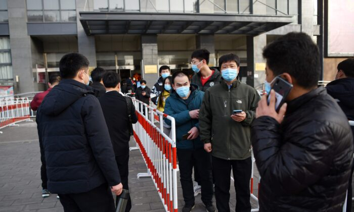 Residents line up outside a community center to be vaccinated against COVID-19 in Beijing on Jan. 12, 2021. (GREG BAKER/AFP via Getty Images)