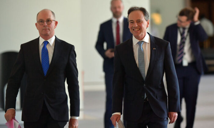 Australia's Acting Chief Medical Officer Paul Kelly (left) and Minister for Health Greg Hunt in the Mural Hall at Parliament House in Canberra, Australia on Dec. 8, 2020. (Sam Mooy/Getty Images)