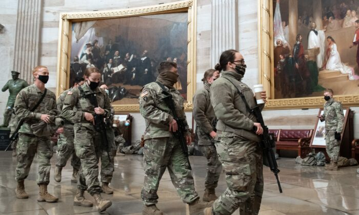 Members of the National Guard walk through the Rotunda of the US Capitol in Washington on Jan. 13, 2021. (Saul Loeb/AFP via Getty Images)
