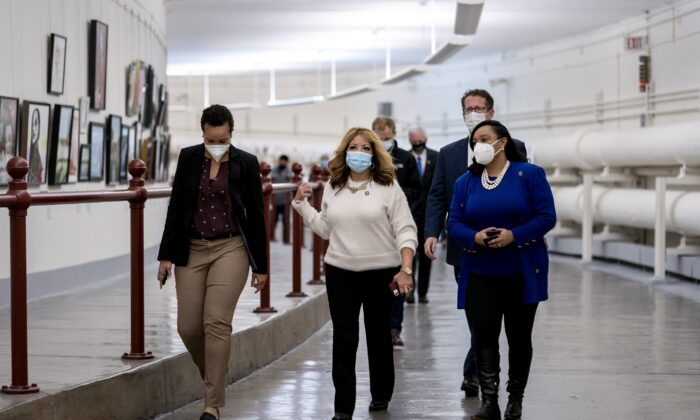 Rep. Lucy Mcbath (D-Ga.) (C) walks while wearing a mask through the Canon Tunnel to the U.S. Capitol in Washington on Jan. 12, 2021. (Stefani Reynolds/Getty Images)