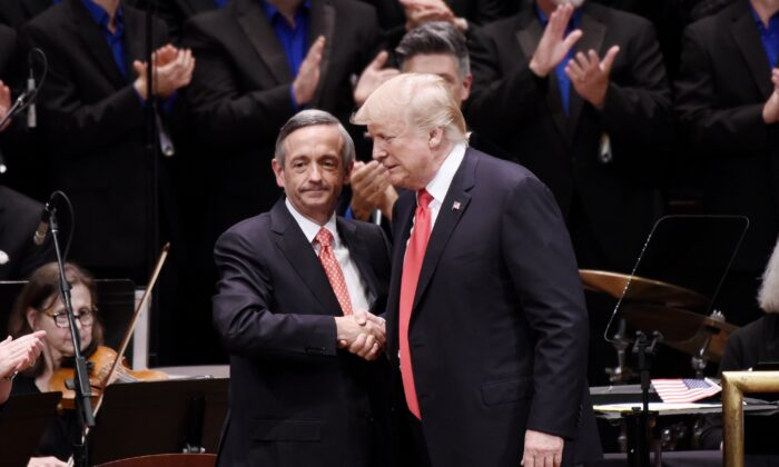 President Donald Trump is greeted by Pastor Robert Jeffress during the Celebrate Freedom Rally at the John F. Kennedy Center for the Performing Arts in Washington on July 1, 2017. (Olivier Douliery/Pool via Getty Images)
