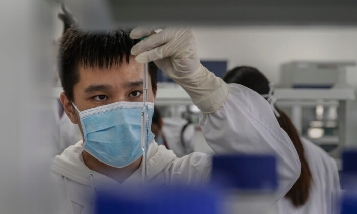 A technician works in a lab at Sinovac Biotech where the company is producing their potential COVID-19 vaccine CoronaVac during a media tour in Beijing, China on Sept. 24, 2020. (Kevin Frayer/Getty Images)