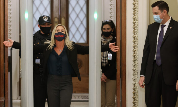 Rep. Marjorie Taylor Greene (R-Ga.) is searched by U.S. Capitol Police after setting off the metal detector outside the doors to the House of Representatives Chamber in Washington on Jan. 12, 2021. (Chip Somodevilla/Getty Images)