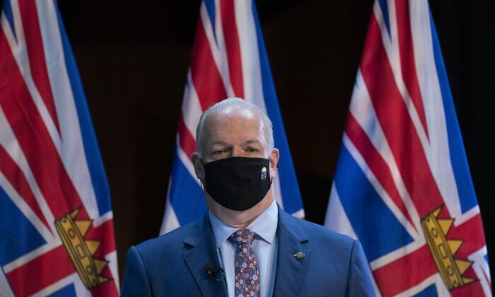B.C. Premier John Horgan wears a protective face mask to help prevent the spread of COVID-19 prior to being sworn in by The Honourable Janet Austin, Lieutenant Governor of British Columbia during a virtual swearing in ceremony in Victoria, on November 26, 2020. (The Canadian Press/Jonathan Hayward)