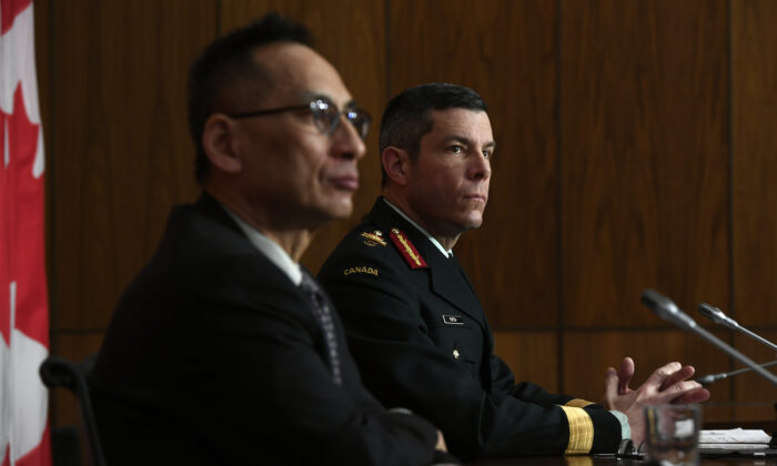 Maj.-Gen. Dany Fortin, Vice-President of Logistics and Operations at the Public Health Agency of Canada (R), and Deputy Chief Public Health Officer Dr. Howard Njoo participate in a news conference on the COVID-19 pandemic in Ottawa, Canada, on  Dec. 30, 2020. (Justin Tang/The Canadian Press)