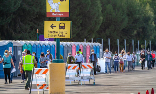 Hundreds Line Up for the Opening of Disneyland Vaccination Center
