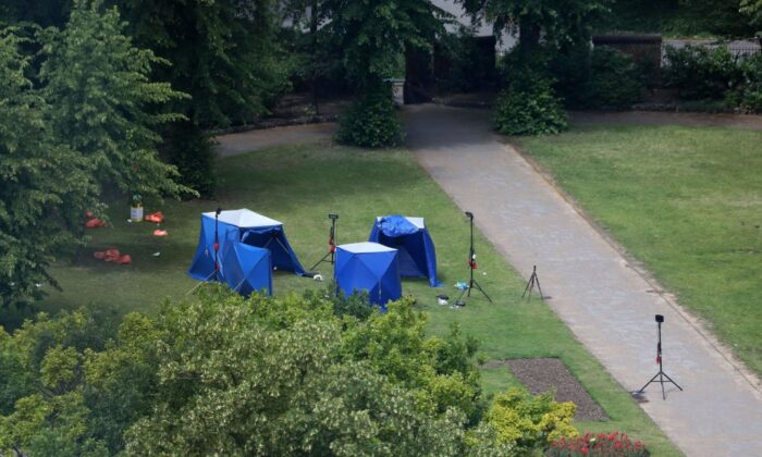 A picture shows police tents and equipment at the scene of a fatal stabbing incident that is being treated as terrorism in Forbury Gardens park in Reading, west of London, on June 21, 2020. (AFP via Getty Images)
