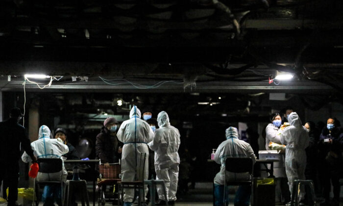 Residents undergo COVID-19 testing in the basement of a residential compound as part of a mass testing program following new cases of the virus emerging in Shijiazhuang, in northern China's Hebei Province on Jan. 12, 2021. (STR/AFP via Getty Images)