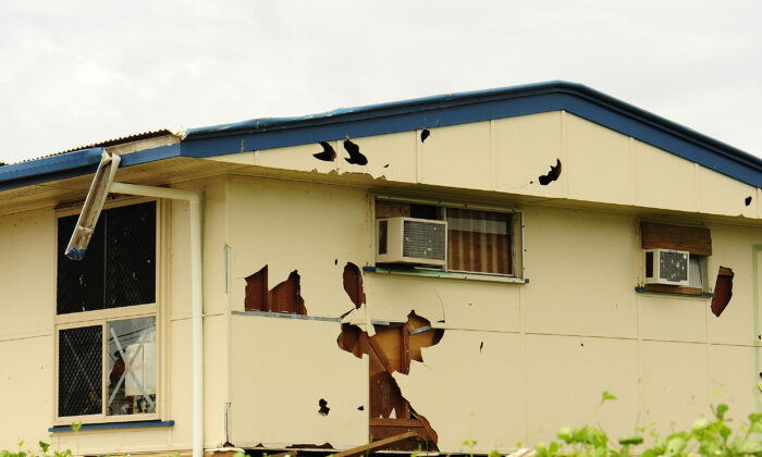 TOWNSVILLE, AUSTRALIA - MARCH 21:  A storm damaged house is seen in the Townsvile suburb of Gulliver  on March 21, 2012 in Townsville, Australia.(Photo by Leigh Turner/Getty Images)