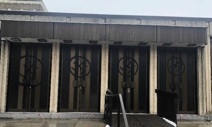 Swatstikas are shown spray painted on the doors of a synagogue in Westmount on Jan. 13, 2021. (The Canadian Press/Rabbi Adam Scheier HO)