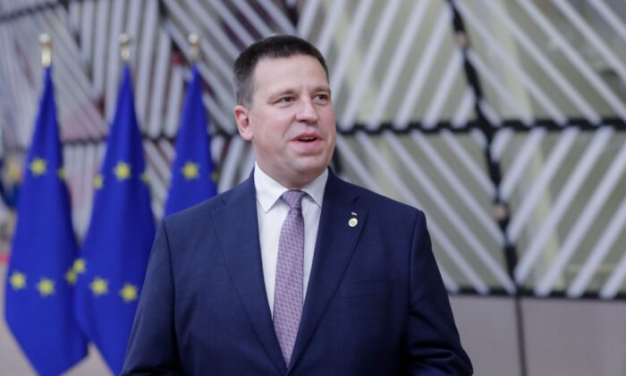 Estonia's Prime Minister Juri Ratas speaks to the press as he arrives on the second day of a European Union (EU) summit at The European Council Building in Brussels on Oct. 2, 2020. (Olivier Hoslet/POOL/AFP via Getty Images)