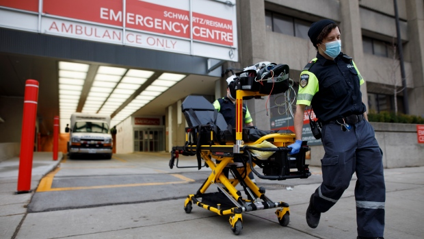 Paramedics wheel a gurney out from the emergency department at Mount Sinai Hospital in Toronto, Jan. 13, 2021. (The Canadian Press/Cole Burston)
