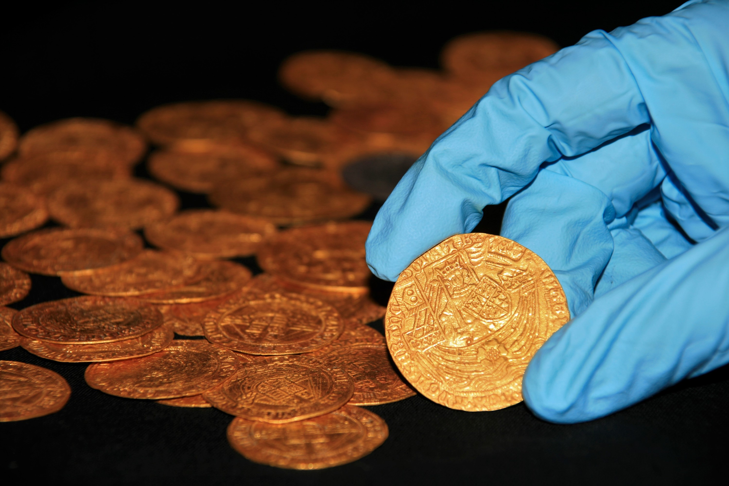 Gardener Digs Up 63 Medieval Gold Coins Inscribed With Initials of Henry VIII's First Three Wives