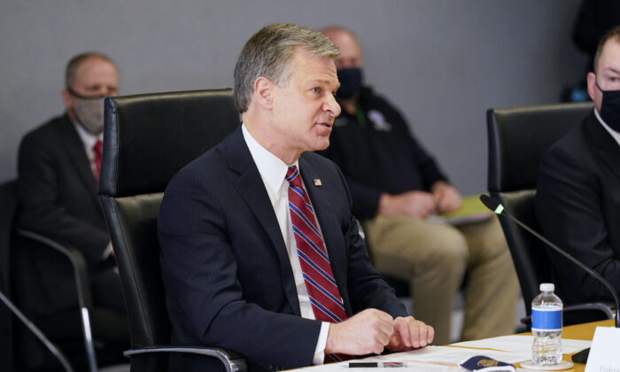 FBI Director Christopher Wray speaks during a briefing about the upcoming presidential inauguration of President-elect Joe Biden and Vice President-elect Kamala Harris, at FEMA headquarters in Washington on Jan. 14, 2021. (Alex Brandon/AP Photo)