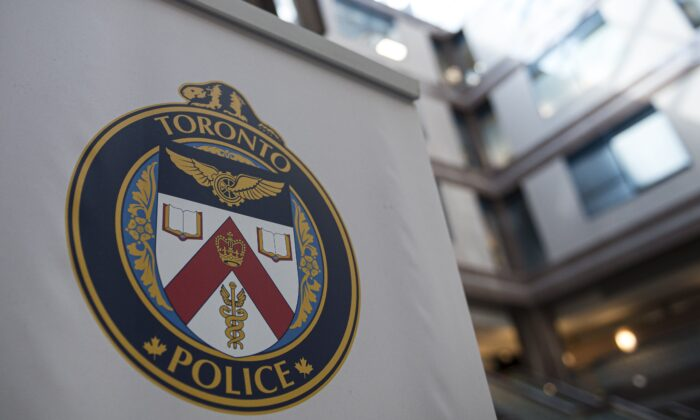 A Toronto Police Services logo is shown at headquarters, in Toronto, on Aug. 9, 2019. (Christopher Katsarov/The Canadian Press)