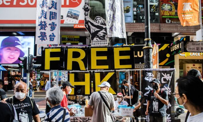 A large display showing the Goddess of Democracy (top C) and lettering that reads 'Free HK' is seen a stall on a pavement near Victoria Park in Hong Kong on June 4, 2020, after an annual vigil that traditionally takes place in the park to mark the 1989 Tiananmen Square crackdown was banned on public health grounds because of the coronavirus pandemic. (Anthony Wallace /AFP via Getty Images)