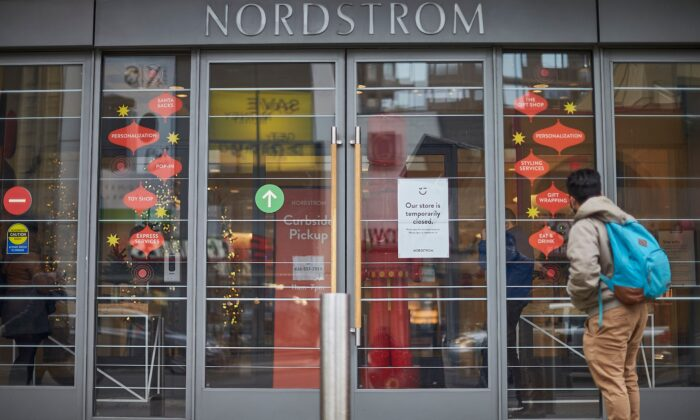 A man stands in front of the Nordstrom store, closed for in-store shopping, in downtown Toronto on Nov. 23, 2020.(Geoff Robins/AFP via Getty Images)