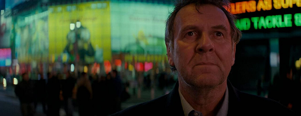 """man standing in Time Square, NY, in """"Michael Clayton"""""""
