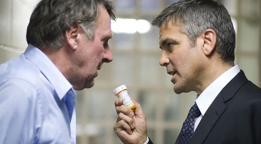 """two men and a bottle of pills in """"Michael Clayton"""""""