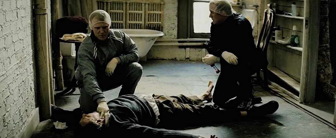 """two men check pulse of dead man in """"Michael Clayton"""""""