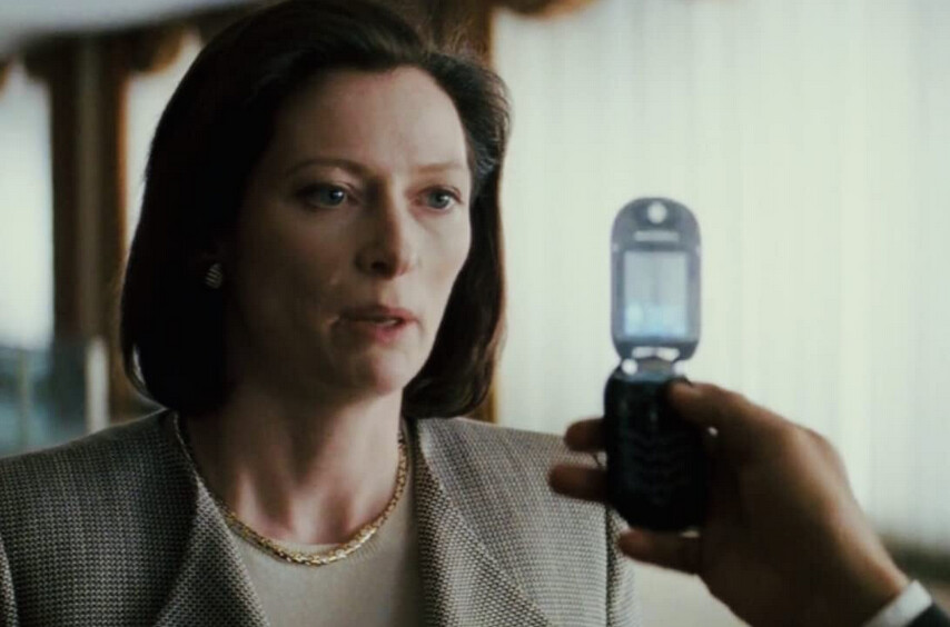 """women staring at cell phone in """"Michael Clayton"""""""