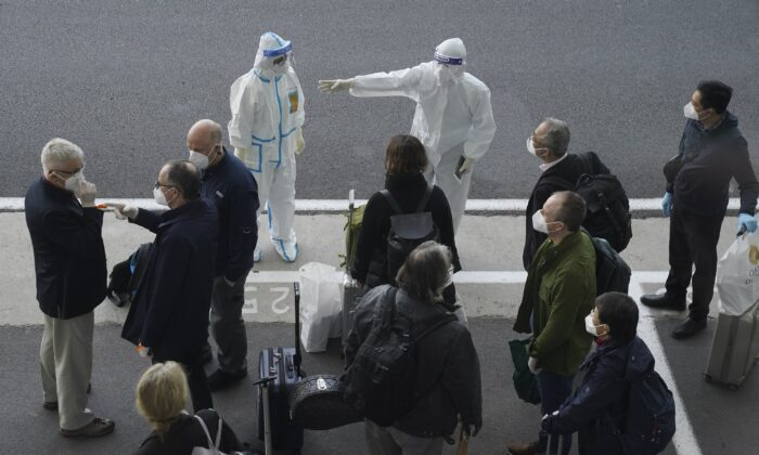 The WHO team arrives in Wuhan city to investigate pandemic origins, in Hubei Province, China, on Jan. 14, 2021. (AP Photo/Ng Han Guan)