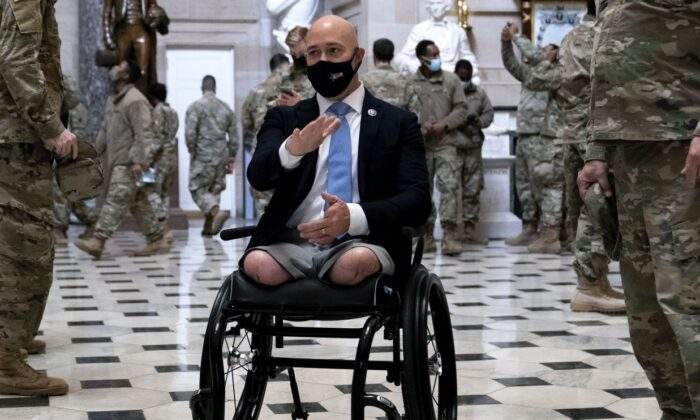 Rep. Brian Mast (R-Fla.) (C) gives members of the National Guard a tour of the U.S. Capitol in Washington, on Jan. 13, 2021. (Stefani Reynolds/Getty Images)