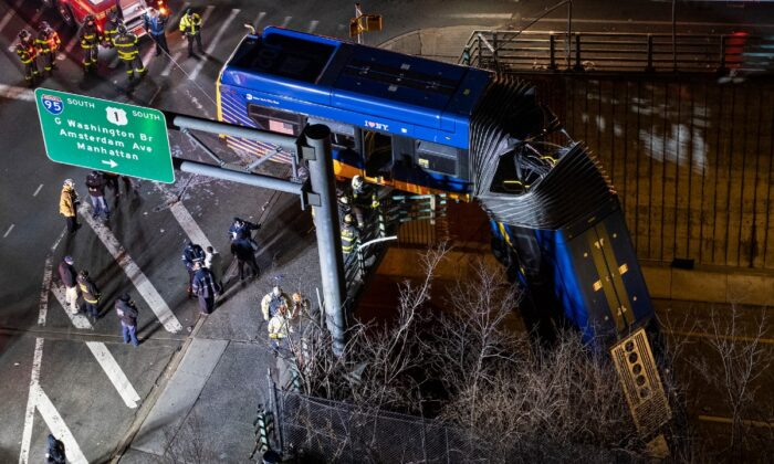 A bus in New York City which careened off a road in the Bronx neighborhood of New York is left dangling from an overpass, on Jan. 15, 2021. (Craig Ruttle/AP Photo)