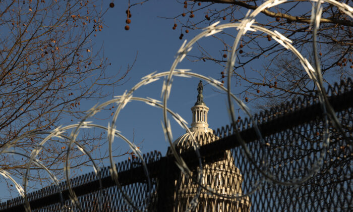 Concertina razor wire tops the 8-foot 'non-scalable' fence that surrounds the U.S. Capitol, in Washington, on Jan. 14, 2020. (Chip Somodevilla/Getty Images)