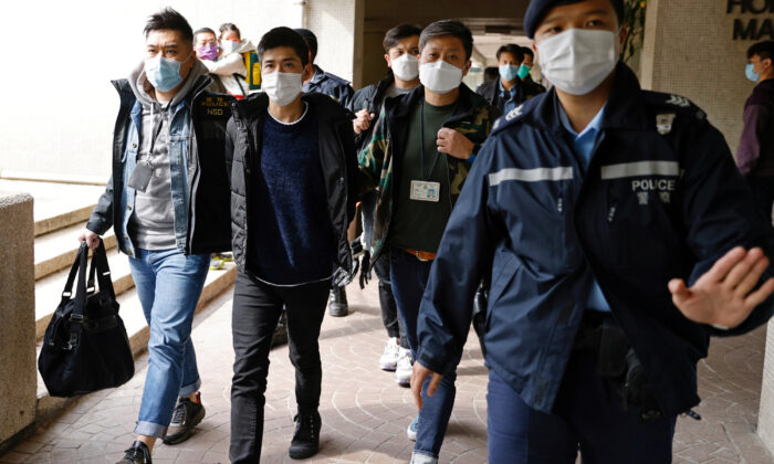 Pro-democracy activist Lester Shum is taken away by police officers in Hong Kong, on Jan. 6, 2021. (REUTERS/Tyrone Siu/File Photo)