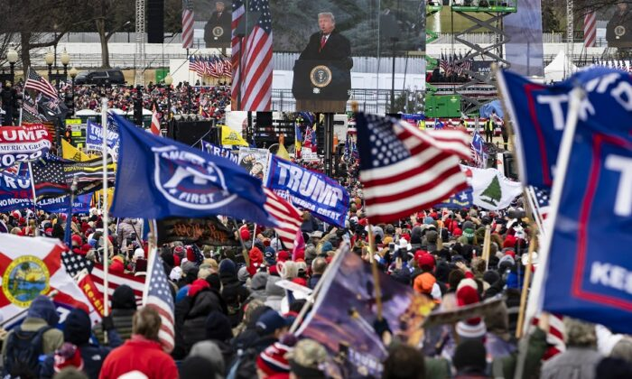 President Donald Trump is seen on a screen as his supporters cheer during a rally on the National Mall in Washington on Jan. 6, 2021. (Samuel Corum/Getty Images)
