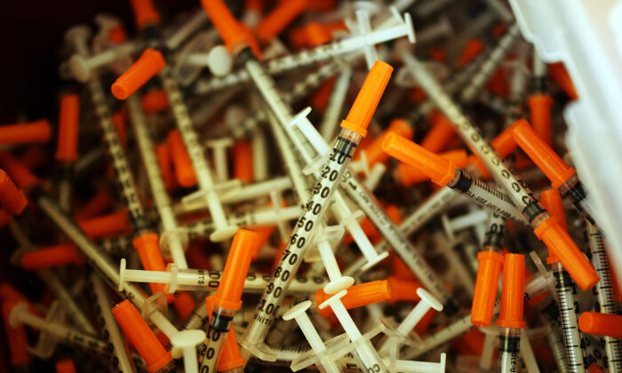 Used syringes are discarded at a needle exchange clinic where users can pick up new syringes and other clean items for those dependent on heroin in St. Johnsbury, Vt. on Feb. 6, 2014. (Spencer Platt/Getty Images)