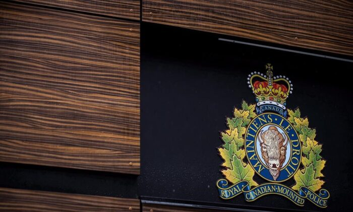 The RCMP logo outside an RCMP building in Surrey, B.C., in a file photo. (Darryl Dyck/The Canadian Press)