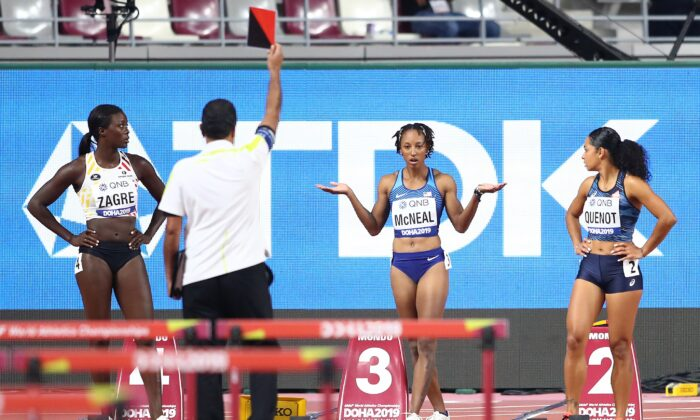 Brianna McNeal of the United States reacts as she is disqualified in the Women's 100 Meters (328 Feet) Hurdles heats of 17th IAAF World Athletics Championships Doha 2019 at Khalifa International Stadium, in Doha, Qatar, on Oct. 05, 2019. (Michael Steele/Getty Images)