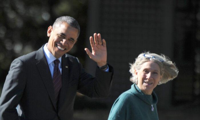 President Barack Obama walks with Senior White House Advisor Anita Dunn to debate preparation at the Kingsmill Resort in Williamsburg, Va., on Oct. 16, 2012. (Mandel Ngan/AFP via Getty Images)