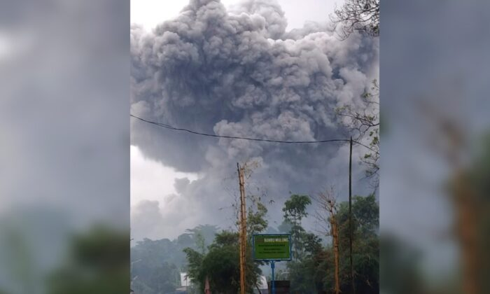 Mount Semeru spews volcanic material during an eruption in Lumajang, East Java, Indonesia, on Jan. 16, 2021. (National Disaster Mitigation Agency via AP)