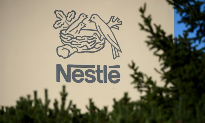 A logo of the world's leading food industry group Nestle is seen on Oct. 9, 2014 at the group's Research Center in Vers-chez-les-Blanc above Lausanne.  (Fabrice Coffrini/AFP via Getty Images)