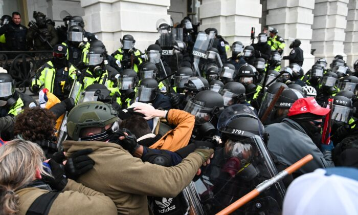 Demonstrators clash with police officers outside the U.S. Capitol building in Washington on Jan. 6, 2021. (Roberto Schmidt/AFP via Getty Images)