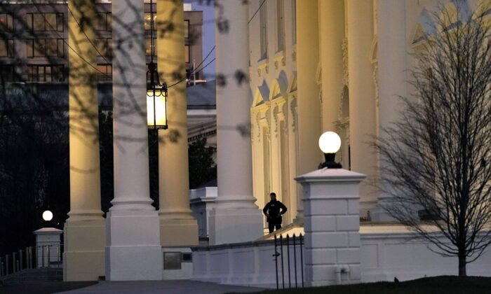A U.S. Secret Service guard is posted at the North Portico of the White House on Jan. 13, 2021. (Gerald Herbert/AP Photo)