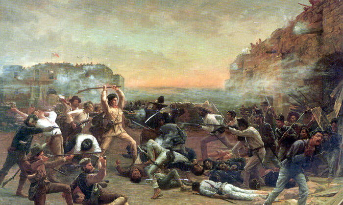 """Famous painting of the last stand made at the Alamo. """"The Fall of the Alamo,"""" 1903, by Robert Jenkins Onderdonk, depicts Davy Crockett wielding his rifle as a club against Mexican troops who have breached the walls of the mission. (Public Domain)"""